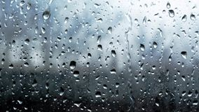 Raindrops on window glass closeup macro slow motion full-HD stock video