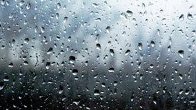 Raindrops on window glass closeup macro slow motion full-HD stock footage