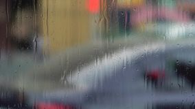 Raindrops on window glass. Blurry background stock video