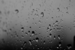 Raindrops on the window glass. Close up stock photos