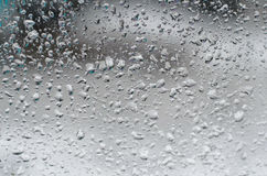 Raindrops on window glass Stock Images