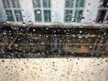 Raindrops on a window glass. Seasonal concept Royalty Free Stock Image