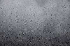 Raindrops on a window with heavy rain outside Stock Photography