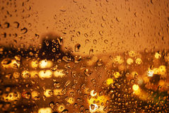 Raindrops on window at night in the city Royalty Free Stock Photography
