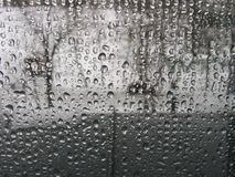 Raindrops on window pane  Royalty Free Stock Images