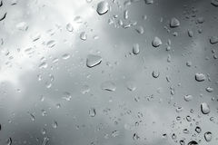 Raindrops on  window pane  a cloudy day Stock Images