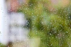Raindrops on a window pane Stock Photos
