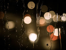 Raindrops on a window pane at night Royalty Free Stock Photo