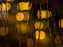 Raindrops on a window pane at night Royalty Free Stock Images