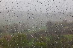 Raindrops on window pane. With landscape of Tuscany in background, Italy stock photos