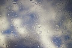 Raindrops on a Window Pane in Stormy Weather stock photo
