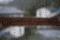 Raindrops on a window pane Royalty Free Stock Photo