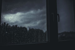 Raindrops on window panes at night Royalty Free Stock Photography