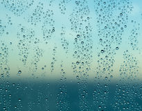 Raindrops on window of a ship at sea with horizon Royalty Free Stock Images