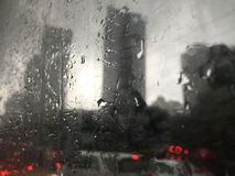 Raindrops on a window with traffic jam Stock Image