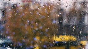 Raindrops on the window way with machines. 1 stock footage