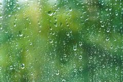Raindrops on windowpane in summer day. royalty free stock images