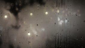 Raindrops on a windowpane stock video footage