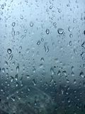 Raindrops windows. The Raindrops beside glass windows Royalty Free Stock Images
