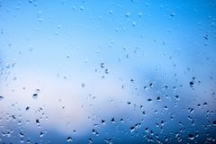 Raindrops on the windshield of the car in the early morning. Transparent glass after rain, cold abstract photo. Texture of glass w royalty free stock photo