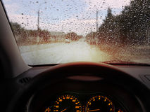 Raindrops on windshield. Dashboard and rain droplets on car windshield Stock Images