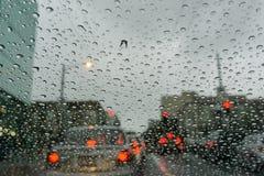 Raindrops on the windshield on a rainy day, traffic light background, San Francisco, California stock image