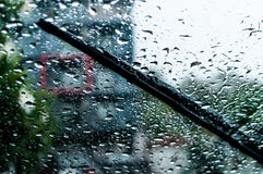 Raindrops and wiper. On car windshield. use wipers and drive slowly in the rain for safety Stock Images