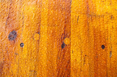 Raindrops on wood texture. Texture of different-shaped raindrops on varnished brown wood Stock Photo