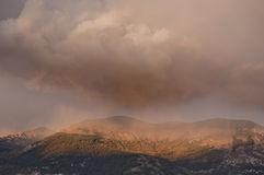 Rainfall on Abruzzi Apennines  at sunset Royalty Free Stock Image
