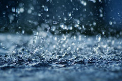 Rainfall in Blue. View of falling rain cast in a blue light Royalty Free Stock Photo