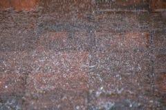 Rainfall. Falling heavy onto garden bricks stock images