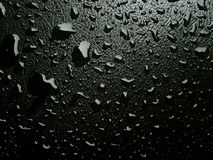Rainfall on a gray background Royalty Free Stock Photography