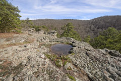 Rainfall Pond on a Rocky Outcrop Stock Images