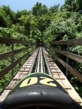 Rainforest Bobsled at Mystic Mountain Jamaica. Bobsledding Jamaica, Ocho Rios. Fun ride through the rainforest of Mystic Mountain. Yah Man royalty free stock photos