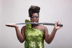 Rainha do arrasto com espada Fotografia de Stock