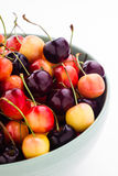 Rainier and black cherries mixed in a bowl Stock Image