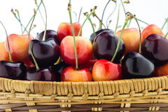 Rainier and black cherries mixed in a wooden basket Stock Photo