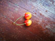 Rainier Cherries fruit lying on ground with different background Stock Photo