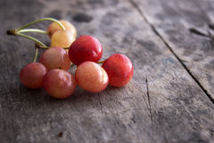 Rainier cherries. On old wooden table, close up Royalty Free Stock Photos