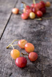 Rainier cherries. On old wooden table, close up Royalty Free Stock Photography