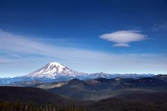 Rainier with UFO Cloud. An amazing UFO shaped cloud hovering over Mount Rainier Royalty Free Stock Photos