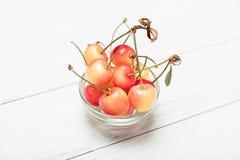 Rainier yellow cherry dessert, delicious bowl with berry.  stock image