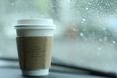 Rainig and coffee. A cup of coffee give a good started Royalty Free Stock Photos