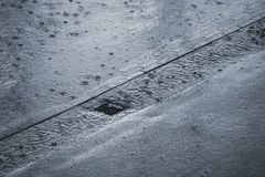 Raining. It is raining cats and dogs - very shallow DOF Royalty Free Stock Images