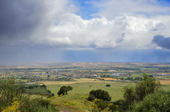Raining above fertile valley Royalty Free Stock Image