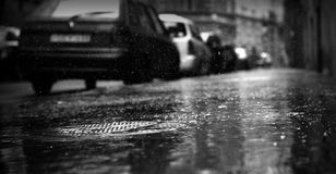 Raining in black and white. Rainy street in Budapest, black and white image Stock Photography