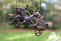 Raining Cats and Dogs. Wind chime with hanging bronze cats and dogs royalty free stock photos
