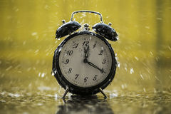 Raining on the clock. Rain is falling on the clock Stock Images