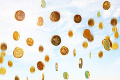 Raining coins. Photo of golden coins raining from the sky Stock Image