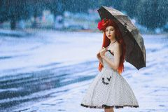 Raining cold climate. Autumn rain fall. Weather change. Sneeze girl in vintage dress hold umbrella. Climate change. Umbrella royalty free stock images